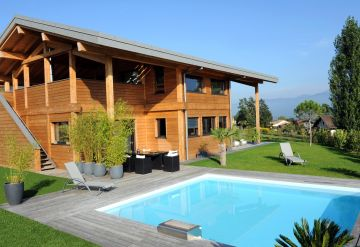 Bo5.5 square pool with a mountain chalet