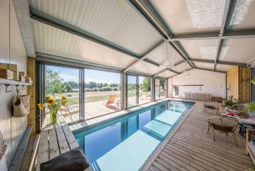 A Cn10 indoor lap pool with a wooden deck