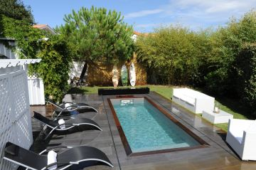 A small Iki model lap pool (permission-exempt) with a deck in a garden