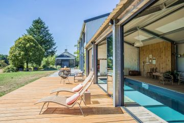 When the patio doors are open and the sun is out, it's an outdoor pool and with the doors closed, it's an indoor lap pool … an installation perfectly combining indoors and outdoors for users' pleasure.