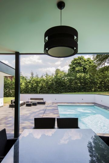 Viewed from the outdoor kitchen, the pool's minimalist look gives the space a Zen-like feel.
