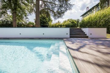 Here, the summertime dream of strolling down the garden stairs, padding across a tiled patio warmed by the sun, testing the water on your Piscinelle pool's Escabanc, and then fully immersing yourself has been made a reality.
