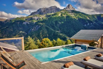 Semi-inground pool outside a mountain gîte in Pra Loup in the Alps