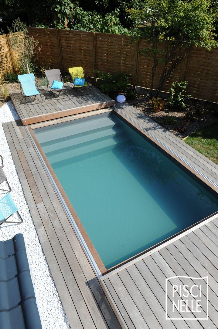 Une petite piscine de nuit avec terrasse mobile en 2 parties for Piscine bois 5mx3m